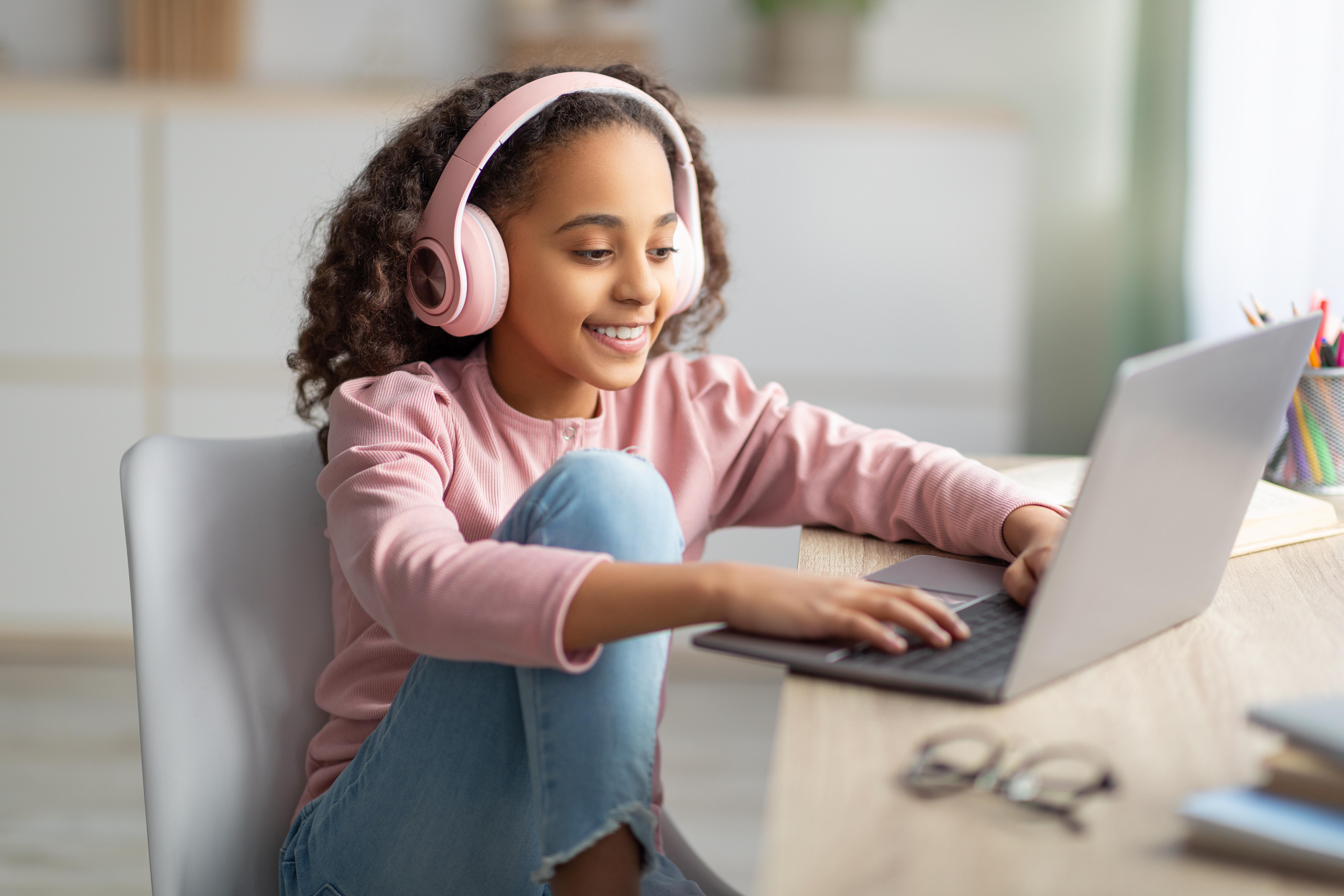 person listening to wireless headphones